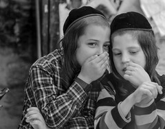 Do Ultra-Orthodox Jewish boys whisper secrets about the girls in their neighborhood? (ybiberman) Tags: portrait boys israel whisper candid secret jerusalem streetphotography palm passover kippah payot meahshearim