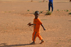 A young child during food distributions in Puntland (Ummah Welfare Trust) Tags: poverty children hope desert islam happiness aid hunger drought humanitarian somalia somaliland puntland humanitarianism poveerty