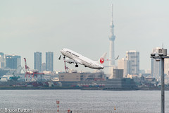 140918 Haneda-15.jpg (Bruce Batten) Tags: japan buildings reflections tokyo aircraft airplanes vehicles jp airports subjects tokyobay locations ota hnd urbanscenery northpacificocean transportationinfrastructure oceansbeaches