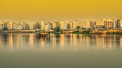 Urbanization!! (ashik mahmud 1847) Tags: house reflection buildings nikkor bangladesh goldenhour d5100