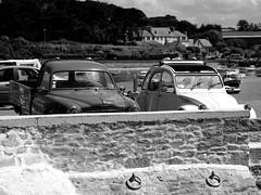 Vintage cars on the quay (patrick_milan) Tags: noiretblanc blackandwhite noir blanc monochrome nb bw black white street rue people personne gens streetview 403 2cv peugeot citroen old car voiture vieille