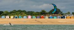 Beach huts and kite surfing (Peter H 01) Tags: summer beach clouds hayling kitesurfing beachhuts