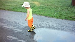 Puddle stomping toddler (Scott SM) Tags: galoshes rubber boots water puddle splash fireman firefighter hat john heinz national wildlife refuge tinicum mud video movie 25 two year old toddler