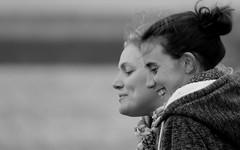 2 smiles 2 (patrick_milan) Tags: noiretblanc blackandwhite noir blanc monochrome nb bw black white street rue people personne gens streetview fminin femal femme woman women girl fille belle beautiful portrait face candide