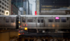 099/365: Elevated rain (dharder9475) Tags: window rain weather train buildings cta bokeh el elevated shallowdepthoffield chicagotransitauthority pedway 2015 pinkline 365project 099365 privpublic