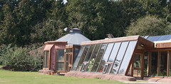 Earthship Brighton, Stanmer Park, Falmer, East Sussex, UK (esaruoho) Tags: uk england house windmill sussex brighton britain united great kingdom solarpanel panels recycling cells eco eastsussex sustainable permaculture sustainability rainwater earthship photovoltaic ecohouse falmer stanmerpark rubbertires brightonearthship lowcarbontrust brightonearthshipproject earthshipbrightonproject