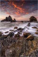 jagged coast (Maciek Gornisiewicz) Tags: morning seascape rock clouds sunrise canon landscape photography dawn coast rocks waves tripod australia camel filter shore nsw newsouthwales maciek bermagui 2015 polariser 1635mm darkelf gornisiewicz jaggedcoast 5diii