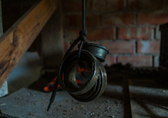 Just hanging (modestmoze) Tags: wood red brown black reflection yellow wall architecture dark spring shadows circles parts bricks may rope things dirty used grease indoors just rings stuff round messy string hanging inside carparts tied planks lithuania tiein 2016 alytus 500px
