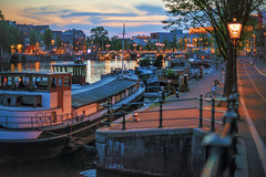 (angheloflores) Tags: street sky people urban netherlands colors amsterdam bike night clouds cityscape bokeh explore amstel susnet