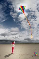 Beacon (Xlavius) Tags: sky kite hot beach girl dark colours bright shade