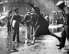 A pedestrian negotiating a burst water main in Theobald's Road, Bloomsbury, London, 16th June 1936. [980773] #HistoryPorn #history #retro http://ift.tt/1NJhL2T (Histolines) Tags: road london history water june 1936 main pedestrian retro bloomsbury timeline burst 16th negotiating theobalds vinatage a historyporn histolines 980773 httpifttt1njhl2t