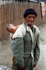 32-114 (ndpa / s. lundeen, archivist) Tags: winter people baby man color fall film hat rural 35mm infant village child nick taiwan oldman tattoos backpack aborigine 1970s aboriginal 1972 hualien 32 taiwanese carry carrying eastcoast sleepingbaby facialtattoos dewolf atayal onhisback republicofchina easterncoast easterntaiwan nickdewolf photographbynickdewolf hualiencounty reel32