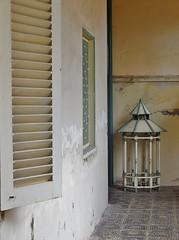 a time capsule (SM Tham) Tags: windows bali building birdcage indonesia island asia interior corridor royal palace shutters walls lantern passageway karangasem amlapura puriagungkarangasem maskerdam