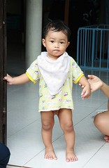 boy in a doorway (the foreign photographer - ) Tags: half naked nude boy doorway mothers hand khlong thanon portraits bangkhen bangkok thailand canon kiss 400d