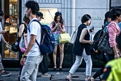 selfie stick (sinkdd) Tags: selfiestick nikon nikond800 d800 nikkor tokyo japan shinjuku street streetsnap streetphotography 85mm f18g girl cap denimshorts