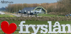 Four Luftwaffe Eurofighters taxi out towards the I love Fryslan sign at Leeuwarden (nigel.conniford) Tags: fighter aircraft aviation jet leeuwarden luftwaffe germanairforce frisianflag eurofighter2000 nikond4 nigelconniford faithle55aolcom apronmedia hertsaviationsociety sigma15006000mmf5063sport