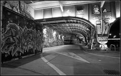 Under the bridge (Donald Noble) Tags: vienna wien bridge light building art water monochrome wall architecture night landscape graffiti austria canal sterreich europe time path