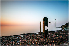 ______|_|__|_ (Kevin HARWIN) Tags: uk blue red sea england sky orange beach water canon eos kent sand rocks long exposure hole britain stones south sigma east 1020mm reculver 70d