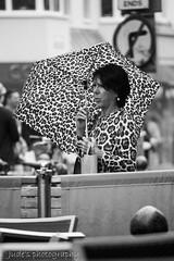camouflage (judethedude73) Tags: street city urban blackandwhite umbrella print sussex blackwhite brighton candid east leopard unposed