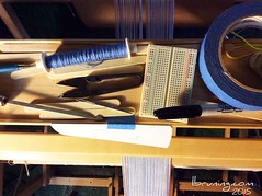 Weaving Supplies on the Nilus LeCleric Castle (eTextile Lounge) Tags: blue warp tools tape hook supplies bobbin weaving loom breadboard pickupsticks handwoven 2015 nilus darningneedle lynnebruning lecleric threadnipps