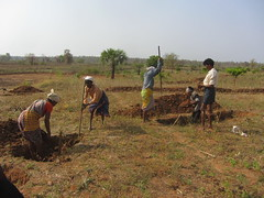 Villagers dig contour trenches