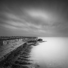 Defence III (Aleksandr Smirnov) Tags: longexposure sea blackandwhite bw seascape monochrome coast minimal m minimalism breakwater waterscape