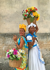 Two young women with cigars (piginka) Tags: old city portrait people flower smiling wall architecture female outdoors happy photography town women basket adult havana cuba young happiness cigar multicolored capitalcity urbanscene traditionalclothing humanface colorimage cubancigar buildingexterior femaleface africandescent builtstructure