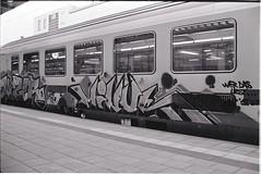 0006 (coloredsteel) Tags: street leica white black self 35mm graffiti stand kodak iso400 f14 trix rodinal developed m6 nokton trainspotting ulm voigtlnder developing trainwriting