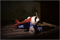 Discarded toy at Pennhurst. (ronnymariano) Tags: blue shadow red color abandoned colors plane toy us unitedstates pennsylvania pa discarded 2016 directionallight springcity pennhurst abandonedamerica
