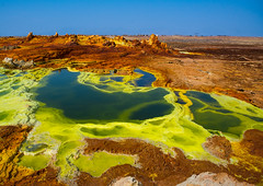 The colorful volcanic landscape of dallol in the danakil depression, Afar region, Dallol, Ethiopia (Eric Lafforgue) Tags: africa travel lake color green tourism nature pool beauty yellow horizontal landscape outdoors volcano spring colorful solitude day desert natural earth acid horizon surreal nobody nopeople formation serenity heat minerals environment sulphur isolation geography geology ethiopia hotspring volcanic saline geothermal interest arid ecosystem hornofafrica afar eastafrica geological abyssinia danakil afarregion dallol danakildepression ethio162030