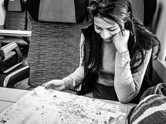 The planner (fabioseda) Tags: travel people blackandwhite white black girl train map planning shirley seda 500px