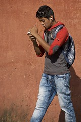 even in Guatemala (Pejasar) Tags: youth male teen boy cellphone walk distracted street candid antigua guatemala