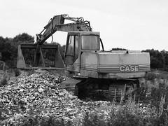 Case Load (Hammerhead27) Tags: old blackandwhite abandoned field grey mono bucket junk industrial arm cab tracks case machinery loader digger hydraulic 888b