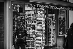 Which one to choose? (LAK.Photography) Tags: bw blackwhite sw schwarzweis schwarzweiss stadt city copenhagen kopenhagen girl postcard postkarten street streetphotography danmark denmark dnemark nikon d810