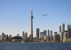 Toronto Skyline (2014) (.annajane) Tags: city lake toronto tower water skyline plane airplane bay cityscape cntower waterfront lakeontario centreisland