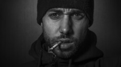 Focus. (EtikPhotography) Tags: selfportrait portrait black white blackandwhite smoke smoking hat contrast cigarette beard focus concentrate meditation wisdom spirituality young man french paris france europe european caucasian people monochrome indoor background texture