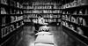 (Thomas Leuthard) Tags: street leica people white black photography flickr sitting fuji thomas streetphotography books olympus bookstore sit monochrom bookshop seated omd bookstores libreria hcb librerias leuthard thomasleuthard