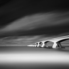 Zeeland Bridge SC (Mabry Campbell) Tags: ocean bridge sea blackandwhite bw seascape holland water monochrome architecture clouds ir photography coast photo europe photographer image fav50 fineart may thenetherlands august zeeland fav20 coastal photograph le infrared 100 fav30 fineartphotography waterscape f63 2014 architecturalphotography schouwenduiveland northerneurope 17mm oosterschelde commercialphotography fav10 noordbeveland fav100 fav200 fav300 720nm ef1740mmf4lusm 2013 fav40 zeelandprovince fav60 zeelandbridge architecturephotography 32sec fav90 fav80 fav70 ongexposure houstonphotographer fav400 oosterscheldeestuary mabrycampbell august102013 201308100h6a4801