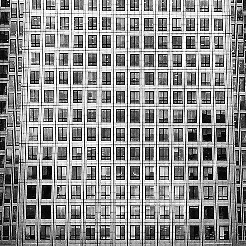 Countless windows, countless dreams. #reality #illusion #dreams #architecture #canarywharf #photosoflondon #photosofengland #London #BW #blackandwhite #monochrome #geometry #layers #multiple #shades #corporate