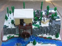 Spring 1945 (tyfighter07) Tags: cliff snow tree mill water river bag spring sand cabin rocks lego wwii watermill moc sdkfz mg42 sdkfz10 mp40 kar98 brickbuilder7