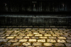 three taps (camerito) Tags: 3 wall austria golden three sterreich flickr wand cement krnten carinthia plaster tap minimalistic j4 pflaster drei gully wasserhahn pflastersteine rinne betonwand minimalistisch nikon1 camerito