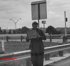 NEED (Halcon122) Tags: street bw usa man texas streetphotography meal needs bexar olympusem5markii