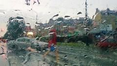 wet magic woman (Bartek Baracz) Tags: street red woman window rain sony lublin xperiaz throwtheglass