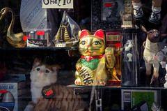 Lucky Cat (elizunseelie) Tags: window shop glitter cat photoshop asian toys gold store junk dolls pentax glasgow object traditional chinese inanimate kitsch sparkle ornaments express tacky waving tat partick clutter crowded k5 lightroom snapseed