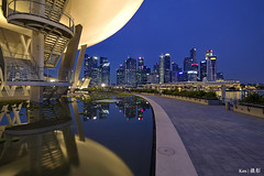 ArtScience Museum Reflection (Ken Goh thanks for 2 Million views) Tags: blue reflection water silhouette skyline night buildings pond singapore pentax sigma hour cbd 1020 centralbusinessdistrict k1 citiscape photographysmooth