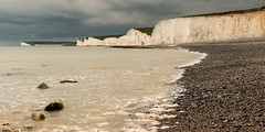 Is this really summer? (Keith in Exeter) Tags: birlinggap eastsussex sevensisters countrypark nationalpark southdowns sea coast beach cliff shingle chalk rock milky cloudy sky landscape seascape outdoor photomerge panorama abigfave