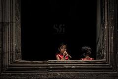 Temple Melodies (Scott Rotzoll) Tags: music window girl stone dark temple cambodia sunny flute newyear instrument recorder angkor wat 2015 kampuchea