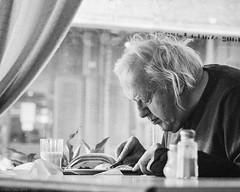 At Lunch (R A Pyke (SweRon)) Tags: old blackandwhite bw man photoshop lunch eating fujifilm hunched xpro1 sweron fujinonxf35mmf14 201404031470
