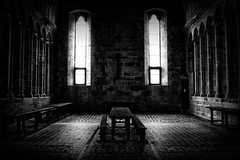 Le Mont Saint-Michel (Missy Jussy) Tags: windows light bw france church monochrome stone architecture canon buildings bench table mono blackwhite worship shadows cross religion monastery normandy churchwindow lemontsaintmichel churchinteriors cannon600d