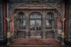 Gothic entrance (TD2112) Tags: wooden iron sinister gothic victorian entrance hastings ironwork hdr highdynamicrange 1885 tiled byzantium neiljordan tonemapped palacecourthotel tonyduke